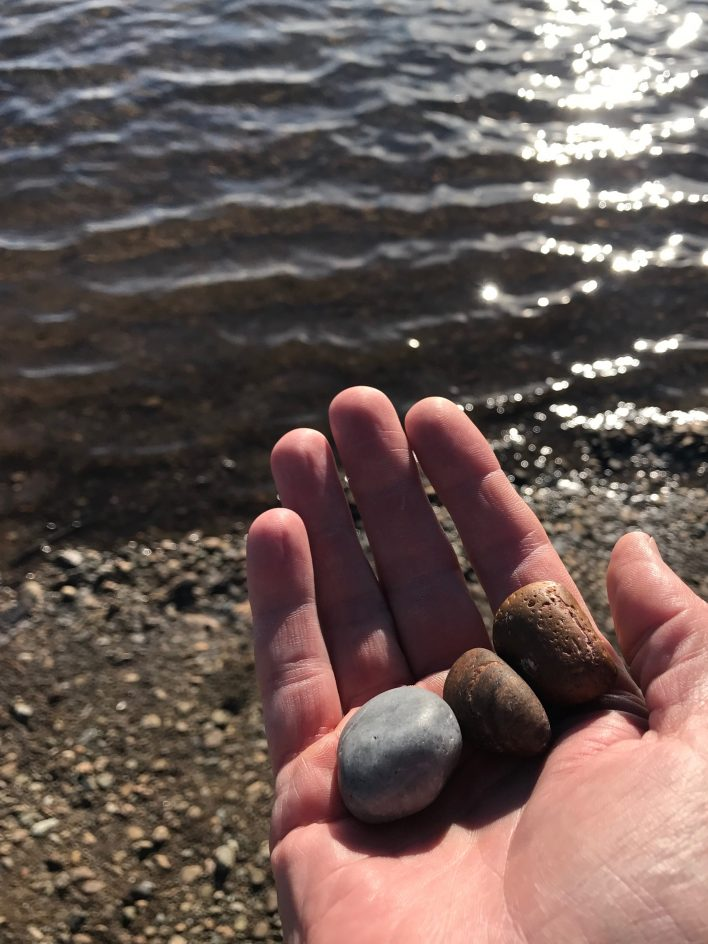 image of three stones in hand used in meditation